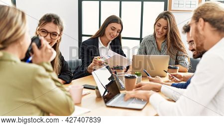 Group of business workers smiling happy working at the office