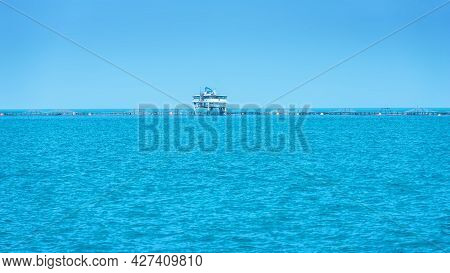View From A Distance On A Sea Farm In Mediterranean Sea, Aquaculture Facility For Growing Seabass An