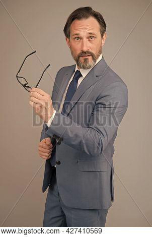 Man With Beard And Glasses Feel Confident. Surprised Looking Businessman In Suit. Handsome Confident