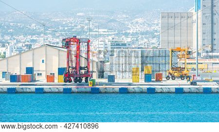 Two Shipping Container Carriers In Front Of Warehouse At Port Cargo Terminal