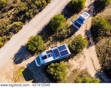 Aerial View. Caravans With Solar Photovoltaic Panels, Charging Batteries On Roof Wild Camping On Spa