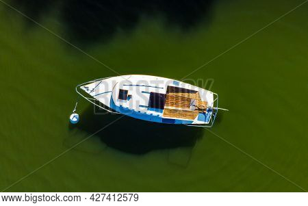 Aerial View Of Small Boat Yacht On Sea Water During Summer. Yachting, Maritime Concept.