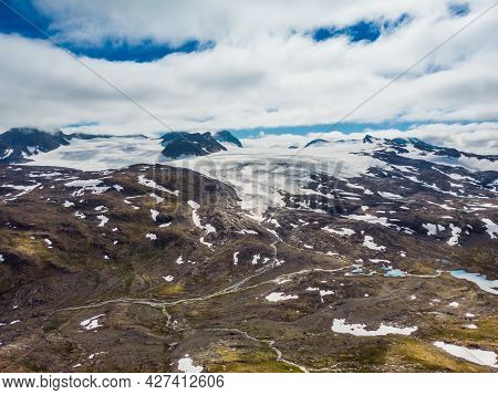 Mountain Landscape In Summertime With Snowy Peaks And Glaciers. National Tourist Scenic Route 55 Sog