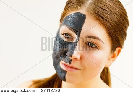 Skin Care. Female With Black Purifying Mud Mask, Deep Cleanser On Half Face. Beauty, Spa And Acne Tr