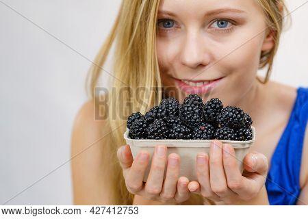Girl Holds Blackberry Fruits