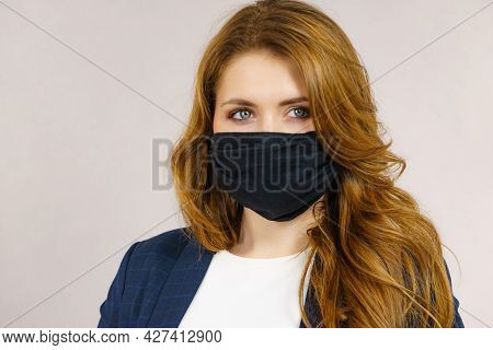 Woman Using Protective Face Mask.