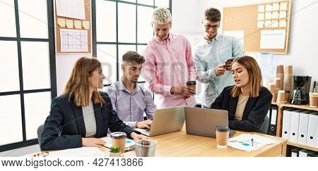 Group of business workers smiling happy working at the office.