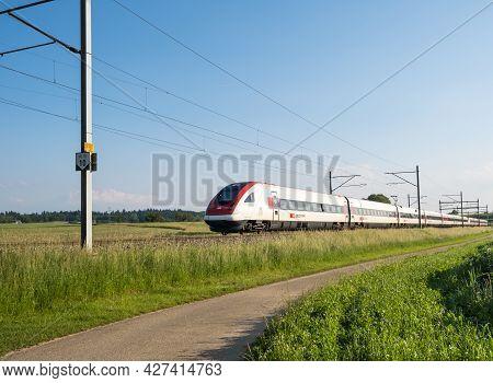 Swiss Tilting Train Sbb Icn Rabde 500 Passing Through Countryside On June 11, 2021 In Niederbipp, Sw
