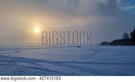 Winter Landscape. A View Of The Frozen Snow-covered Lake. Forest In The Background.