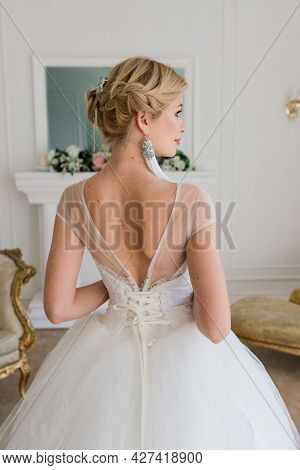 Art Photo Of Gentle Pretty Female With Blond, Bride, Gorgeous Expensive White Dress