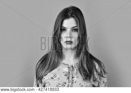 Girl Perfect Beautiful Makeup. Hairstyle And Makeup. Woman Confident Face With Makeup On Pink Backgr