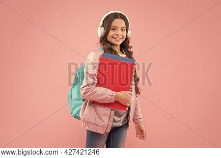 Improve Your Listening Skills. Happy Child Wear Headphones Holding Books. Language School. Learning