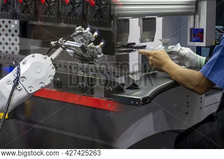 The Abstract Scene Comparison Between The Robotic And Human  Operator Working With Bending Machine.