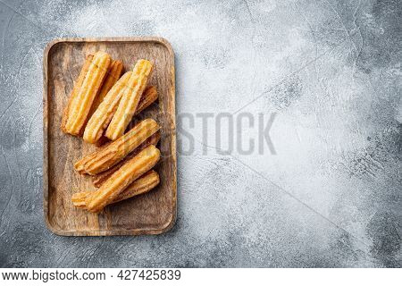 Churros With Caramel, Traditional Spanish Cusine, On Gray Background, Top View Flat Lay With Space F