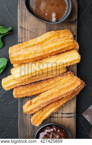 Churros With Chocolate, Traditional Spanish Cusine, On Black Background, Top View Flat Lay