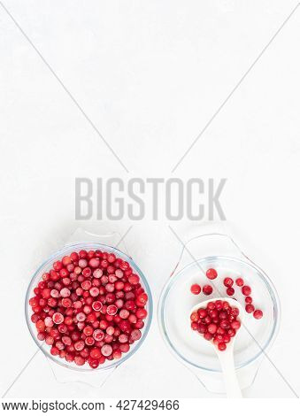 Frozen Cranberries In A Bowl On A White Background. Frozen Red Berries. Vertical Orientation. View F