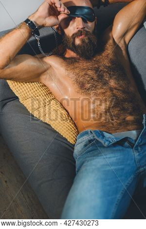 Portrait Of A Brutal Bearded Man With A Naked Torso.
