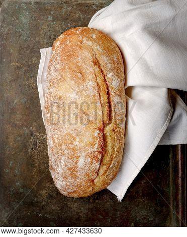 Sliced Organic Bread Ciabatta On Vintage Linen Napkin. Top View Of Homemade Ciabatta. Flat Lay.
