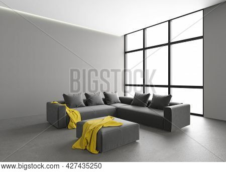 Large Semi-empty Salon With A Large Sofa. Large Windows In The Interior. Empty Walls In The Apartmen