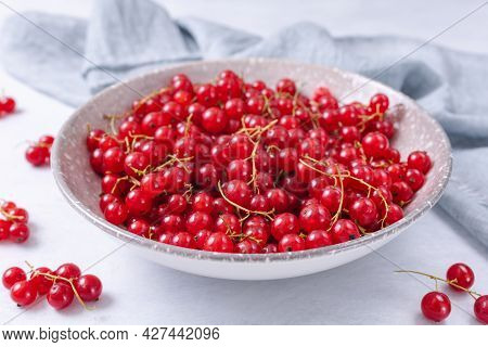 Fresh Red Currant In Wooden Bowl On Grey Table. Summer Fruit Berry On Light Backgound. Healthy Fruit