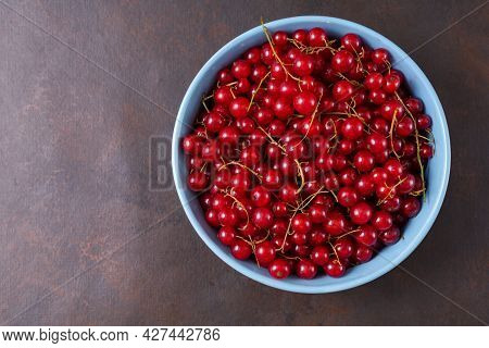 Fresh Red Currant In Wooden Bowl On Dark Table. Summer Fruit Berry. Healthy Fruits And Food