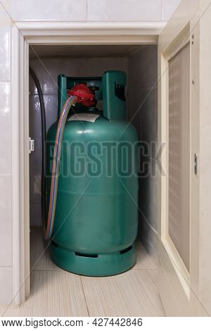 The Lpg Gas Tank For Cooking Is Stored In The Small Storage Compartment Near The Gas Stove Bar In Th