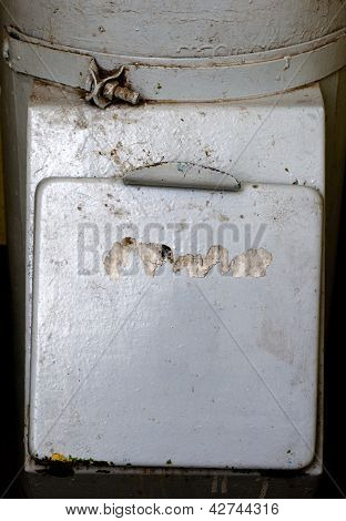 square cover of the old garbage chute