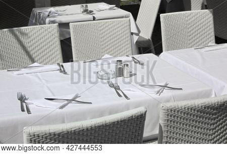 Set Table With White Tablecloths And White Chairs In The Restaurants Waiting For The Tourists