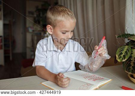 Happy Left-handed Boy Put His Left Hand In Plastic Glove To Avoid Messy, International Left-hander D
