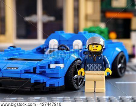 Tambov, Russian Federation - July 02, 2021 Lego Driver Minifigure Near Her Car Mclaren Elva By Lego