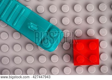 Tambov, Russian Federation - January 17, 2021 Lego Teal Brick Separator With Res Brick On Gray Basep