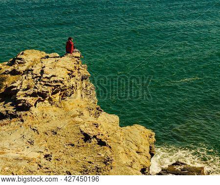 Tourist Woman On Spanish Rocky Coastline In Murcia Region. Mediterranean Sea Coast Landscape, Calbla