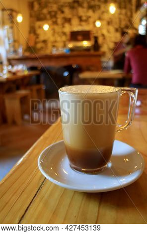 Frothy Iced Cappuccino Coffee On The Wooden Table