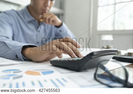 Finances Saving Economy Concept. Accountant Or Banker Calculate The Cash Bill.