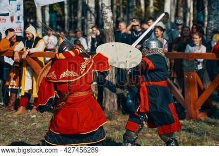 Fights Among Women In Armor. Two Females Warrior Fighting In Competition Of Warriors. Reconstruction
