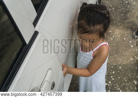 Kid Hand Or Finger Pinched By The Car Door; Close Up Portrait Of Finger Pinched, Slammed By The Car