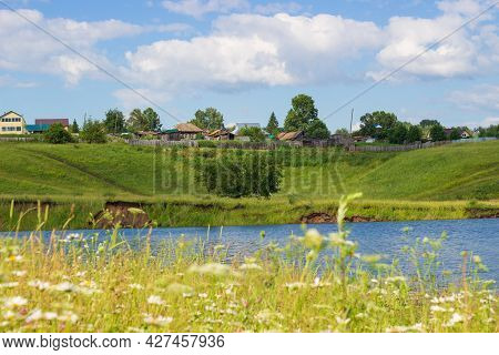 Rural Summer Landscape With Village By The River Bank In Siberia, Russia