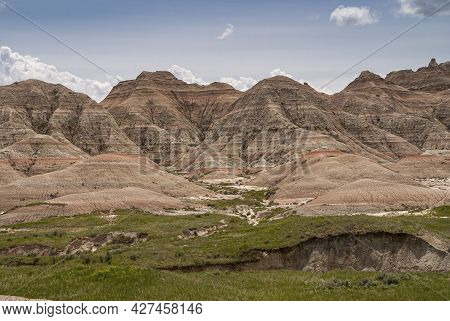 Badlands National Park, Sd, Usa - June 1, 2008: Horizontal Stripes Of Different Colors Over Entire M