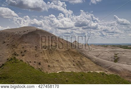 Badlands National Park, Sd, Usa - June 1, 2008: Part Of Mountain Shifted Away In Scene With Beige Ge