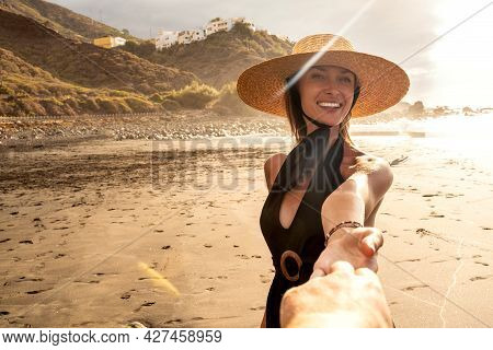 Beautiful Woman Portrait In Sunset. Smiling Happy Female Model Wearing Summer Hat, Looking At Camera