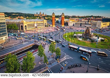Aerial view of Placa d'Espanya, Plaza de Espana, the Spanish Square in Barcelona, Catalonia, Spain with city traffic on sunset