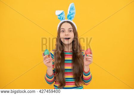 Amazed Easter Teen Girl In Rabbit Bunny Ears Holding Painted Eggs For Holiday Egg Hunt, Bunny Hunt