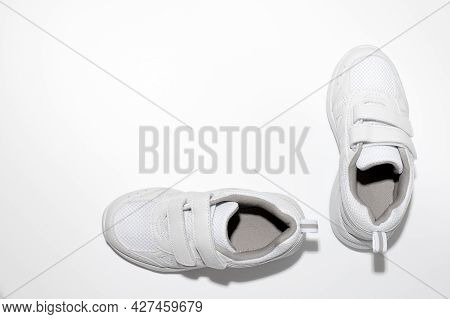 Mock Up White Childrens Sneakers With Velcro Fasteners For Easy Footwear Isolated On A White Backgro