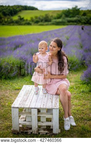 Mother With Her Little Daugher On Lavender Field Background, Czech Republic