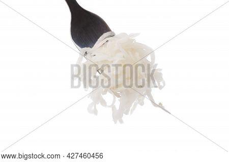 Sauerkraut On A White Background. Pickled Cabbage Close-up In A Fork On A White Background.