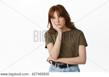 Image Of Bored And Gloomy Young Woman, Student Lean Face On Hand And Look Uninterested Aside, Attend