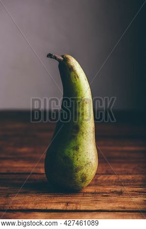 Still Life With Conference Pear On Wooden Tabletop