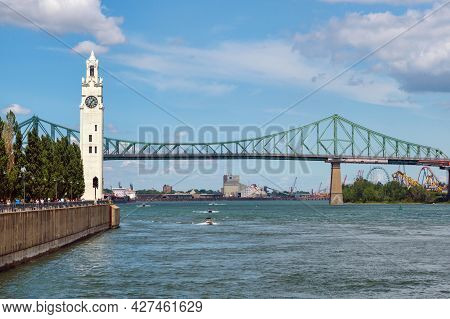 Montreal, Ca - 4 July 2021: Montreal Clock Tower And Jacques Cartier Bridge In Spring