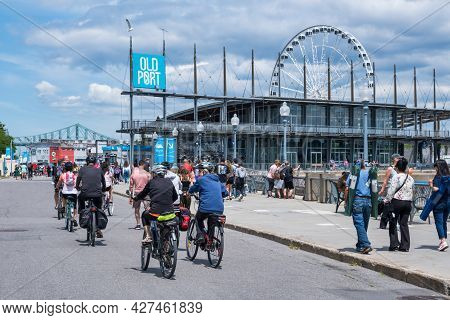 Montreal, Ca - 4 July 2021: People Walking In The Old Port Of Montreal On A Sunny Summer Day