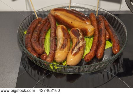View Of Fried Sausages On Big Plate. Hotdogs Concept. Homemade Food Concept. Sweden.